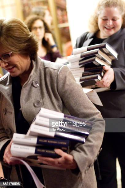 Fans carry copies of What Happened by Hillary Clinton while attending a Clinton book tour stop at the Academy of Music in Philadelphia PA on November...