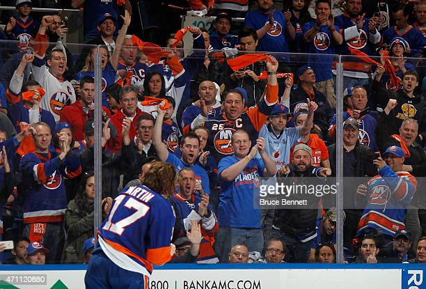 Fans cclap for Matt Martin of the New York Islanders as he is escourted to the penalty box during the second period against the Washington Capitals...