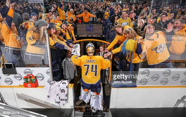 Fans celebrate a 10 shutout win against the Vegas Golden Knights with Juuse Saros of the Nashville Predators during an NHL game at Bridgestone Arena...