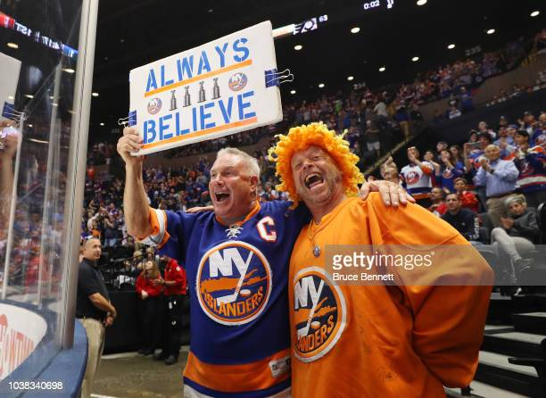 Fans celebrate a first period goal by Cal Clutterbuck of the New York Islanders against the Philadelphia Flyers during a preseason game at the Nassau...