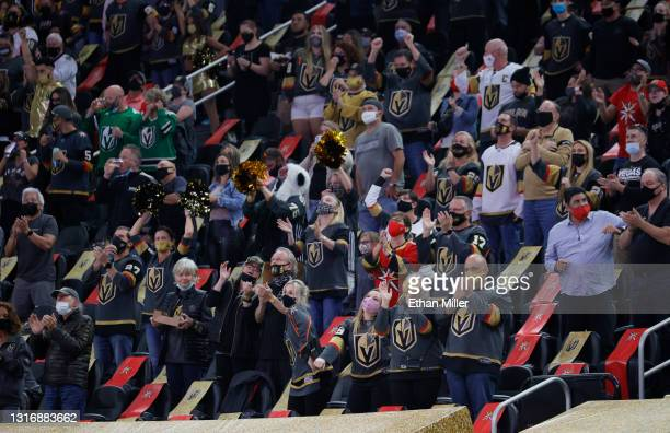 Fans celebrate a first-period goal by Reilly Smith of the Vegas Golden Knights against the St. Louis Blues during their game at T-Mobile Arena on May...