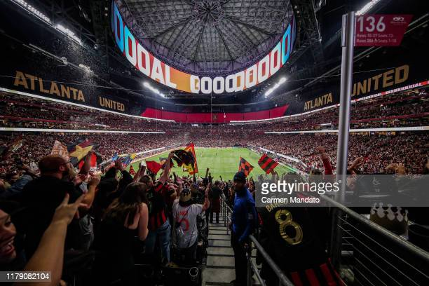Fans celebrate a goal scored by Julian Gressel of Atlanta United during the first half of the Eastern Conference Finals between Atlanta United and...