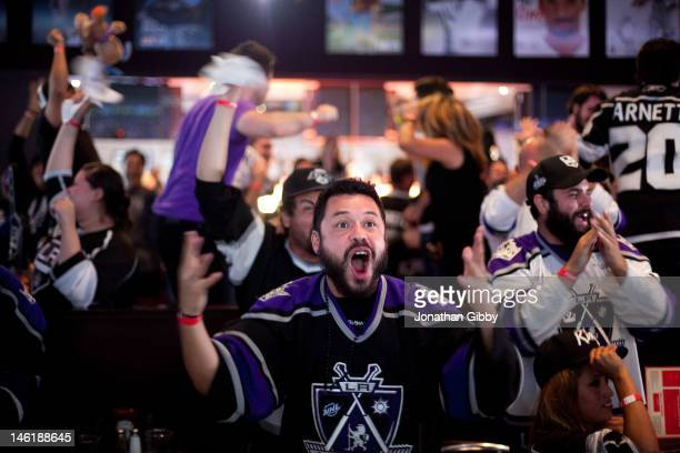 Fans celebrate a goal scored by the Los Angeles Kings during Game 6 of the 2012 Stanley Cup Final June 11, 2012 in Los Angeles, California. A win in...