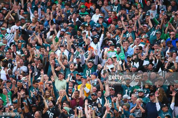 Fans celebrate a touchdown by unning back Corey Clement of the Philadelphia Eagles celebrates against the Denver Broncos during the third quarter at...