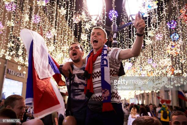 Fans celebrate a victory by the Russian team after the 2018 FIFA World Cup group A match against Egypt on June 19 2018 in Moscow Russia