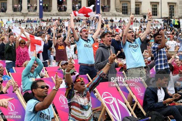 Fans celebrate a wicket during the ICC Cricket World Cup Final at the London fanzone at Trafalgar Square during the ICC Cricket World Cup 2019 on...