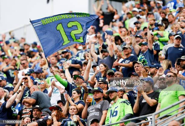 Fans celebrate after a Seattle Seahawks touchdown against Cincinnati Bengals at CenturyLink Field on September 8, 2019 in Seattle, Washington.