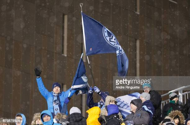 Fans celebrate after a touchdown by the Toronto Argonauts against the Calgary Stampeders during the second half of the 105th Grey Cup Championship...
