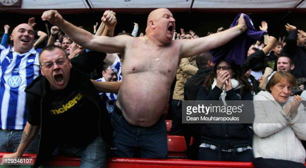 Fans celebrate after Gary Madine of Sheffield Wednesday scores his teams second goal during the npower League One match between Sheffield United and...