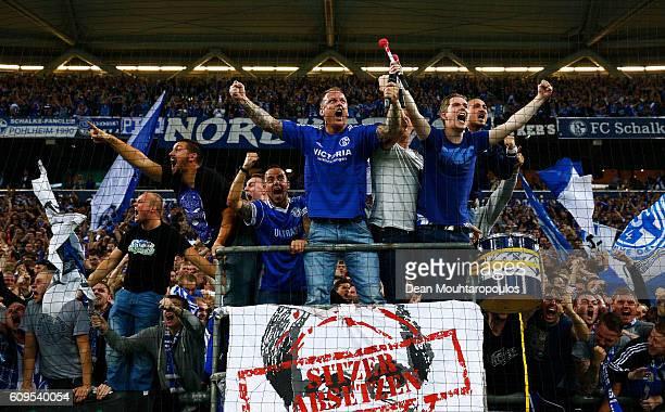 Fans celebrate after KlaasJan Huntelaar of Schalke scores his teams first goal of the game during the Bundesliga match between FC Schalke 04 and 1 FC...