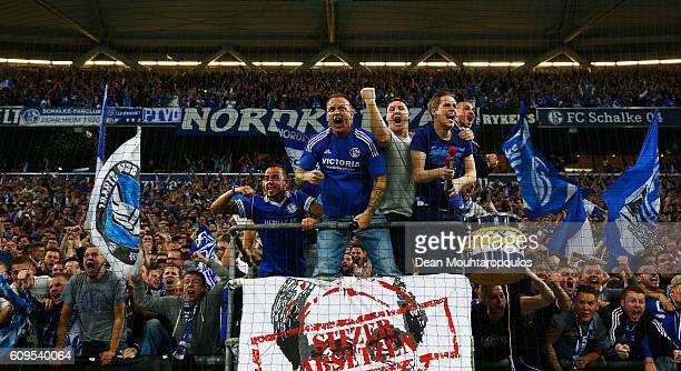 Fans celebrate after KlaasJan Huntelaar of Schalke scores his teams first goal of the game during the Bundesliga match between FC Schalke 04 and 1 FC...