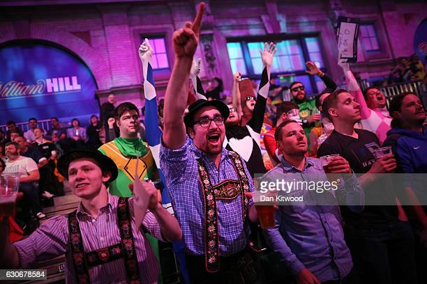 Fans celebrate after Peter Wright from Scotland threw a 180 during the quarter final of 2016 William Hill World Darts Championship on December 30...