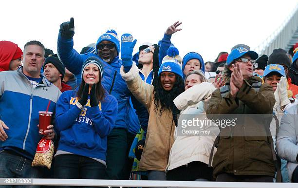 ** UCLA fans celebrate after the Bruins beat the Utah Utes during the second half of a college football game at Rice Eccles Stadium on November 21...