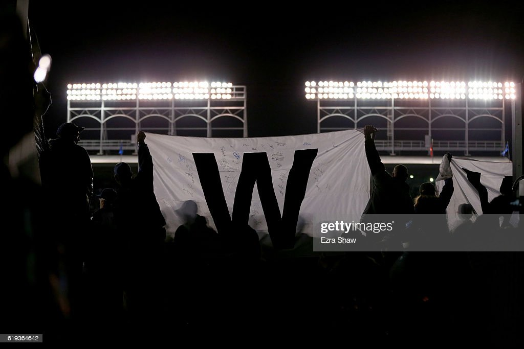 Fans celebrate after the Chicago Cubs beat the Cleveland Indians 3-2 in Game Five of the 2016 World Series at Wrigley Field on October 30, 2016 in Chicago, Illinois.