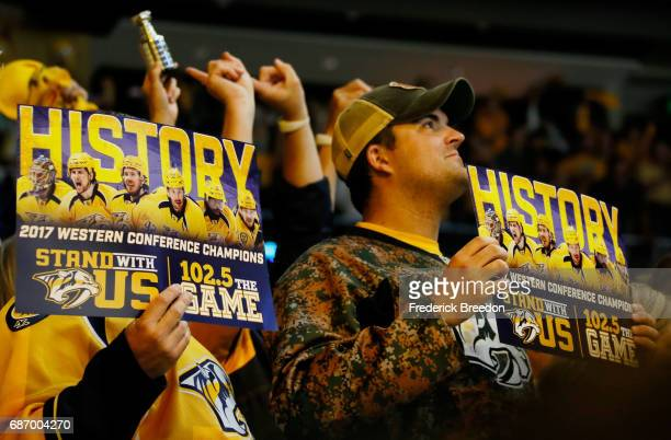 Fans celebrate after the Nashville Predators defeated the Anaheim Ducks 6 to 3 in Game Six of the Western Conference Final during the 2017 Stanley...