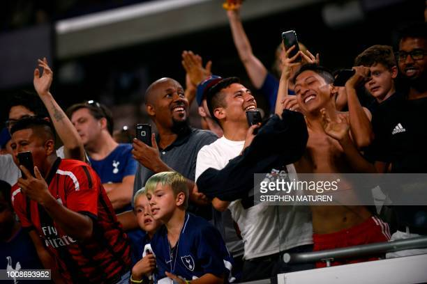 Fans celebrate after the Tottenham Hotspur defeated AC Milan 10 in their International Champions Cup friendly football match at US Bank Stadium in...