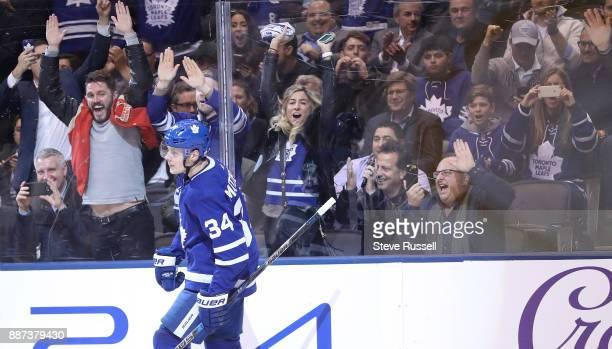 TORONTO ON DECEMBER 6 Fans celebrate after Toronto Maple Leafs center Auston Matthews scores in the shootout as the Toronto Maple Leafs beat the...