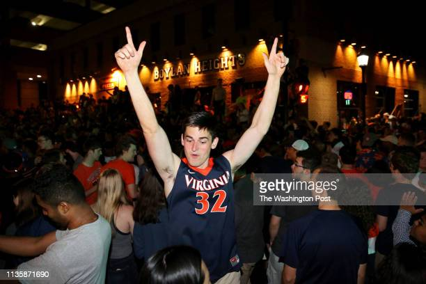 Fans celebrate along University Ave in Charlottesville, Virginia after Virginia won the NCAA basketball championship.