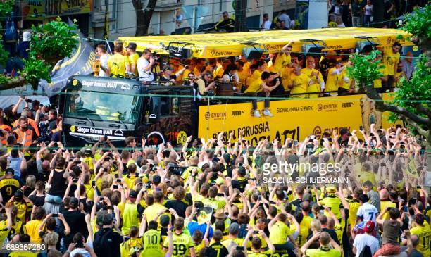 Fans celebrate as a truck with the team of BVB Borussia Dortmund arrives during celebrations after winning the German Cup final in Dortmund western...