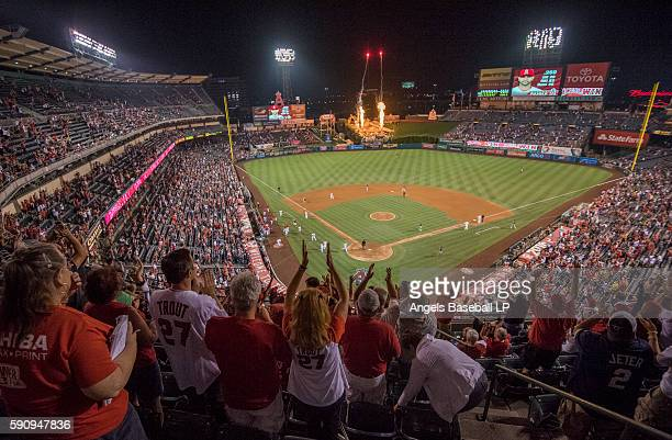 Fans celebrate as Albert Pujols of the Los Angeles Angels of Anaheim runs the bases after hitting a walkoff tworun home run during the ninth inning...