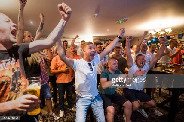 Fans celebrate as England win on penalties during the FIFA 2018 World Cup Finals match between Colombia and England at The Lord Stamford public house...