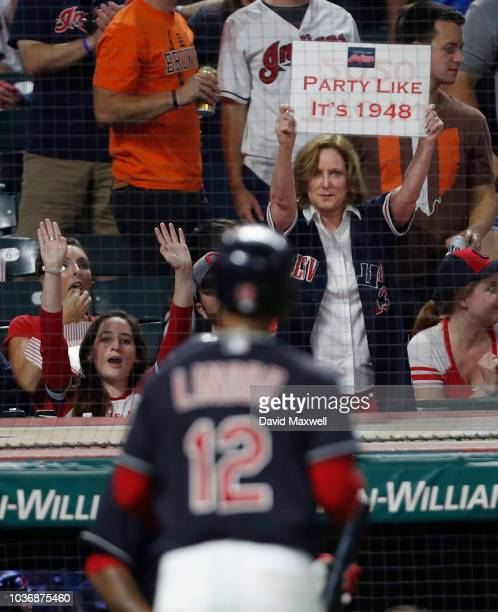 Fans celebrate as Francisco Lindor of the Cleveland Indians returns to the dugout after hitting a home run against the Chicago White Sox in the third...