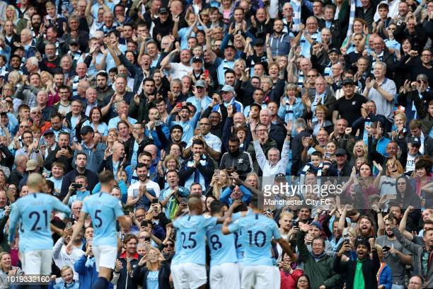 Fans celebrate as Gabriel Jesus of Manchester City celebrates with teammates after scoring his team's second goal during the Premier League match...