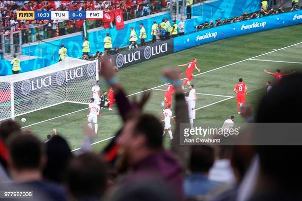 Fans celebrate as Harry Kane scores for England as they play Tunisia in the group stages of the 2018 FIFA World Cup tournament on June 18 2018 in...