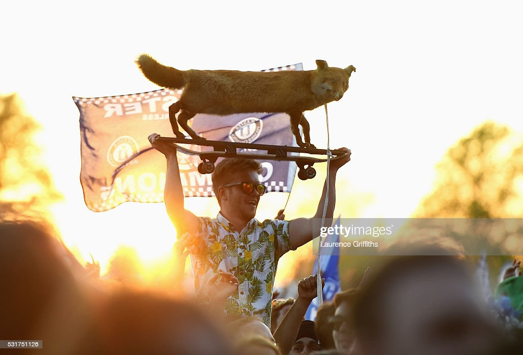 Fans celebrate as Kasabian play a live set during the Leicester City Barclays Premier League winners bus parade on May 16, 2016 in Leicester, England.