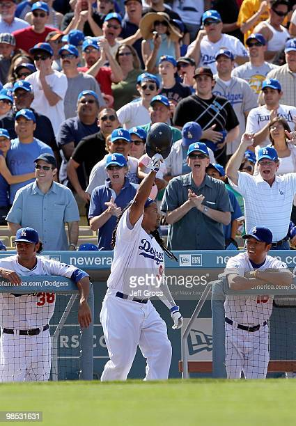Fans celebrate as Manny Ramirez of the Los Angeles Dodgers comes out for a curtain call after hitting a tworun homerun in the eighth inning against...