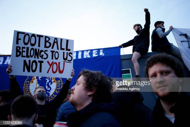 Fans celebrate as news breaks that Chelsea Football Club are to withdraw from the breakaway European Super League during a demonstration against the...