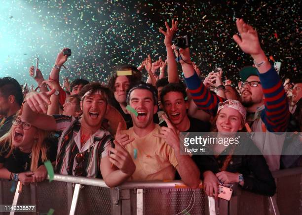 Fans celebrate as Tame Impala performs during Day 2 of 2019 Boston Calling Music Festival on May 25 2019 in Boston Massachusetts