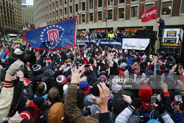 Fans celebrate as the parade passes City Hall Plaza during New England Patriots Super Bowl LI Victory Parade in Boston on Feb 7 2017