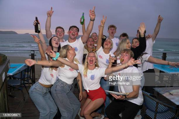 Fans celebrate as they watch the UEFA Euro 2020 Championship Final between Italy and England at Fistral Beach Bar on July 11, 2021 in Newquay, United...