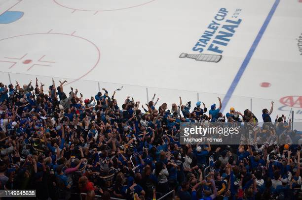 Fans celebrate at the Stanley Cup Final Game 7 Watch Party between the Boston Bruins and the St. Louis Blues at the Enterprise Center on June 12,...