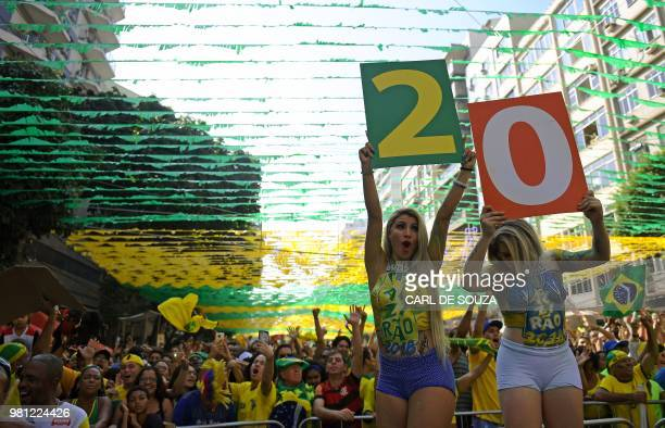 Fans celebrate Brazil's victory against Costa Rica after watching their FIFA World Cup Russia 2018 football match in a giant screen at the Alzirao...