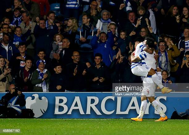 QPR fans celebrate Charlie Austin's 2nd goal during the Premier League match between Queens Park Rangers and Aston Villa at Loftus Road on October 27...