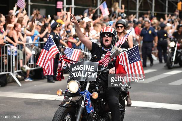 Fans celebrate during a Victory Ticker Tape Parade for the US Women's National Soccer Team down the Canyon of Heroes on July 10 2019 in the Manhattan...