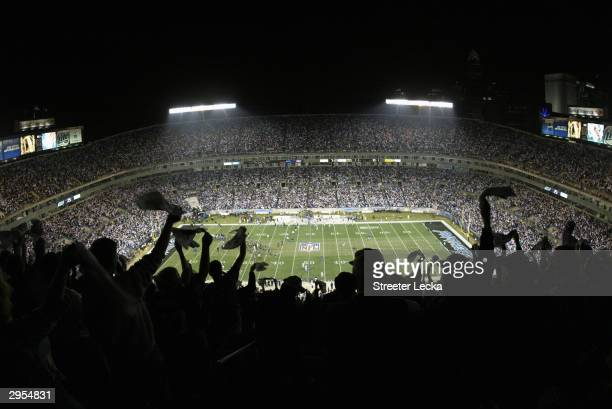 Fans celebrate during start of the NFC Wildcard game between the Dallas Cowboys and the Carolina Panthers at Ericsson Stadium on January 3, 2004 in...