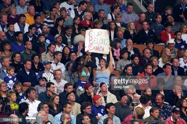 Fans celebrate during the game between the Pittsburgh Penguins and the Toronto Maple Leafs during the 1999 Quarter Finals of the NHL playoff game...