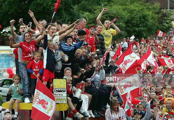 Fans celebrate during the homecoming victory parade through the streets of Liverpool on May 26 2005 in Liverpool England Liverpool defeated AC Milan...