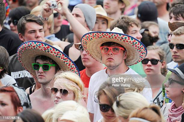 Fans celebrate during the second day of Rock Am Ring on June 04 2011 in Nuerburg Germany