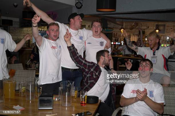 Fans celebrate during the UEFA Euro 2020 Championship Final between Italy and England at Fistral Beach Bar on July 11, 2021 in Newquay, United...