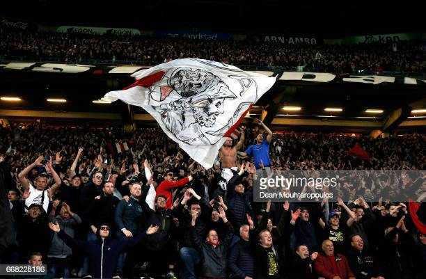 Fans celebrate during the UEFA Europa League quarter final first leg match between Ajax Amsterdam and FC Schalke 04 at Amsterdam Arena on April 13...