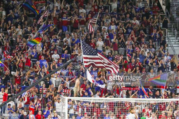 Fans celebrate during the World Cup Qualifying soccer match between the US Mens National Team and Panama on October 6 2017 at Orlando City Stadium in...