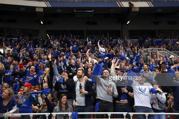 Fans celebrate during the XFL game between the Seattle Dragons and the St. Louis BattleHawks at The Dome at America's Center on February 29, 2020 in...