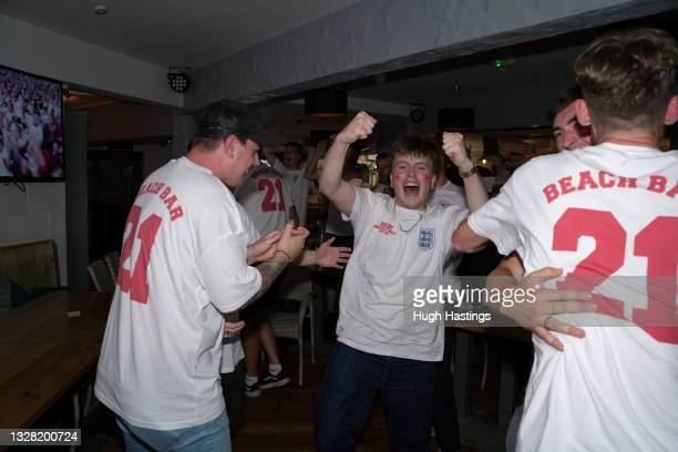 Fans celebrate England's first goal during the UEFA Euro 2020 Championship Final between Italy and England at Fistral Beach Bar on July 11, 2021 in...