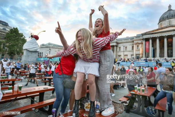 Fans celebrate England's second goal as they watch the euro 2020 quarter final match between England and Ukraine from inside the Fan Zone set up to...