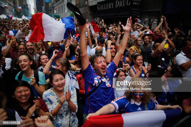 Fans celebrate France's fourth goal during a watch party for the World Cup final between France and Croatia on July 15 2018 in New York City France...