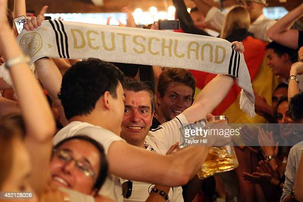 Fans celebrate Germany's 10 victory in 2014 FIFA World Cup final at the German beer garden Reichenbach Hall on July 13 2014 in New York City